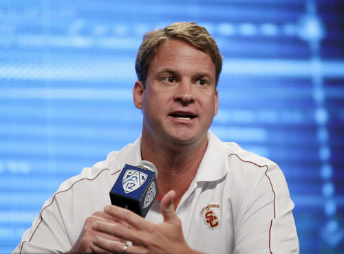 Southern California head coach Lane Kiffin talks to the media at the NCAA college football Pac-12 media day on Friday, July 26, 2013, in Culver City, Calif. (AP Photo/Jae C. Hong)