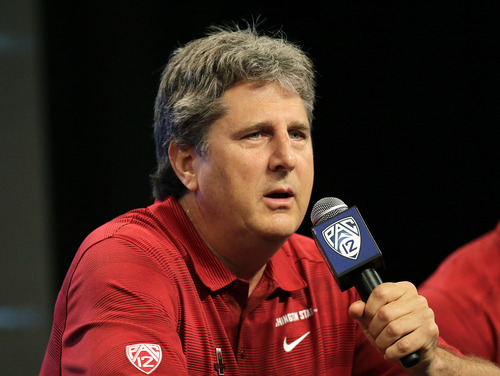 Washington State head coach Mike Leach talks to the media during the NCAA college football Pac-12 Media Day on Friday, July 26, 2013, in Culver City, Calif. (AP Photo/Jae C. Hong)