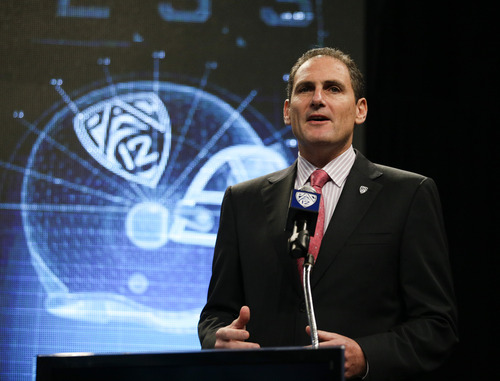 Pac-12 Commissioner Larry Scott talks to the media during the NCAA college football Pac-12 Media Day on Friday, July 26, 2013, in Culver City, Calif. (AP Photo/Jae C. Hong)