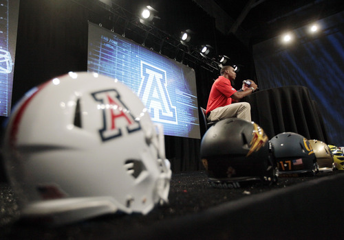 Arizona wide receiver Terrence Miller speaks during the Pac-12 football media day, Friday, July 26, 2013, in Culver City, Calif. (AP Photo/Jae C. Hong)