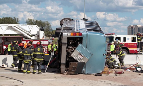 Firefighters work to extricate people from a bus crash Saturday, July 27, 2013 in Indianapolis. The Indianapolis Fire Department says three people were killed when a bus carrying teens from a church camp crashed on a busy thoroughfare near Interstate 465. The bus was carrying 40 passengers who are members of Colonial Hill Baptist Church and were returning from camp when the crash happened Saturday afternoon. (AP Photo/The Indianapolis Star, Michelle Pemberton) NO SALES