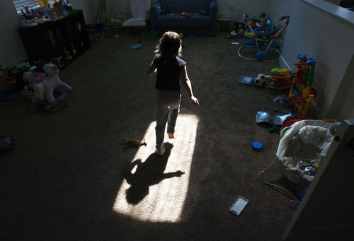 Steve Griffin | The Salt Lake Tribune   A child runs through the light as it shines through a skylight at the Family Support Center's Crisis Nursery in West Valley CIty, Utah Thursday July 18, 2013.