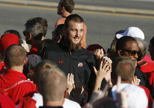 "Scott Sommerdorf  |  The Salt Lake Tribune              Utah LB Trevor Reilly greets fans at the ""Ute Walk"" prior to the game at Rice-Eccles stadium, Saturday, September 15, 2012."