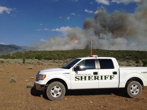 Courtesy of Sanpete County Sheriff's Office A grass fire sends up smoke last week east of Spring City, which is about two miles south of Mount Pleasant. While details are scarce, the Sanpete County Sheriff's Office said that the flames are threatening structures
