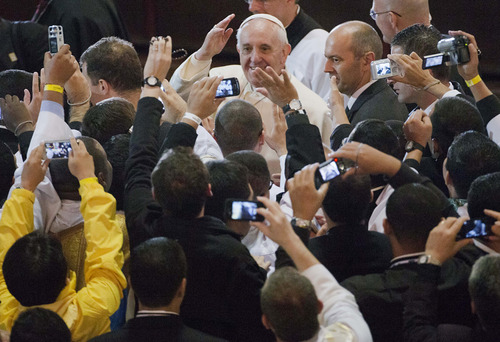 Pope Francis arrives for a Mass at the Cathedral in Rio de Janeiro, Brazil, Saturday, July 27, 2013. Pope Francis on Saturday challenged bishops from around the world to get out of their churches and preach, and to have the courage to go to the farthest margins of society to find the faithful. (AP Photo/Domenico Stinellis)