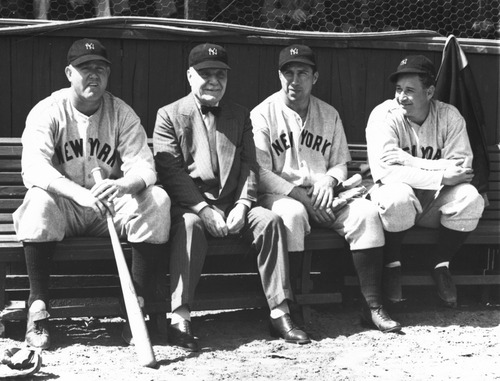ADVANCE FOR WEEKEND EDITIONS, JULY 27-28 - FILE - In this March 17, 1938 file photo, Col. Jacob Ruppert, second from left, owner of the world champion New York Yankees, sits with pitcher Paul Andrews, left, outfielder Ernie Koy and pitcher Bump Hadley, right, during spring training baseball in St. Petersburg, Fla. Ruppert, longtime umpire Hank O'Day and barehanded catcher Deacon White will be inducted in the National Baseball Hall of Fame this weekend. (AP Photo/File)