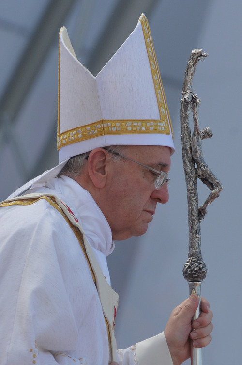 "Pope Francis holds his papal crucifix during the World Youth Day's concluding Mass on the Copacabana beachfront in Rio de Janeiro, Brazil, July 28, 2013. Francis wrapped up a historic trip to his home continent Sunday with the Mass on Copacabana beach, urging the young people on hand to go out and spread their faith ""to the fringes of society, even to those who seem farthest away, most indifferent."" (AP Photo/Luca Zennaro, Pool)"