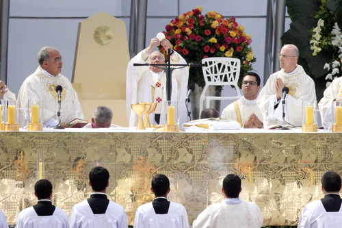 Pope Francis celebrates Mass on Copacabana beach, in Rio de Janeiro, Brazil, Sunday, July 28, 2013. Francis wrapped up is historic trip to his home continent Sunday with a Mass that drew a reported 3 million people. (AP Photo/Victor R. Caivano)