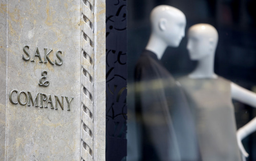 FILE - This Aug. 15, 2011, file photo shows Saks & Company in New York. Hudson's Bay, the parent of Lord & Taylor, is purchasing Saks for approximately $2.4 billion. Hudson's Bay will pay $16 per share for Saks, a 5 percent premium over the company's Friday, July 26, 2013 closing price of $15.31. (AP Photo/Seth Wenig, File)