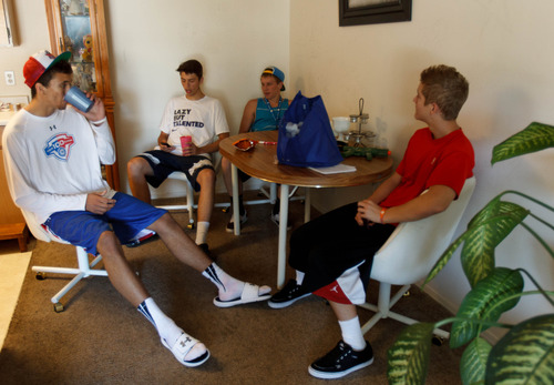 Trent Nelson     The Salt Lake Tribune Roy High School's Brekkott Chapman, left, hangs out with friends Chase Deboer, Alex Eddy and Chris Stuck. Chapman is becoming somewhat of a national phenomenon. The 6-foot-8 lefty has been invited to several national, high-end basketball camps this summer and has been the best player at nearly every one. Friday June 21, 2013 in Roy.