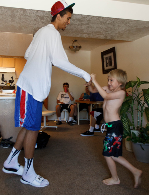 Trent Nelson     The Salt Lake Tribune Roy High School's Brekkott Chapman plays with his younger brother Troy Littlefield Friday June 21, 2013 in Roy.. Chapman is becoming somewhat of a national phenomenon. The 6-foot-8 lefty has been invited to several national, high-end basketball camps this summer and has been the best player at nearly every one.