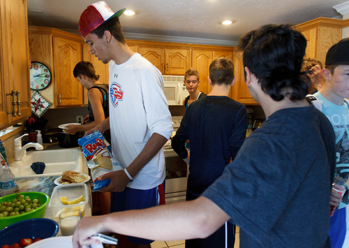 Trent Nelson     The Salt Lake Tribune Roy High School's Brekkott Chapman having lunch with his friends at his grandparents' home Friday June 21, 2013 in Roy.. Chapman is becoming somewhat of a national phenomenon. The 6-foot-8 lefty has been invited to several national, high-end basketball camps this summer and has been the best player at nearly every one.