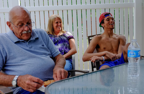 Trent Nelson     The Salt Lake Tribune Roy High School's Brekkott Chapman, right, with his grandfather Dennis Price and mother Kim Littlefield. Chapman is becoming somewhat of a national phenomenon. The 6-foot-8 lefty has been invited to several national, high-end basketball camps this summer and has been the best player at nearly every one. Friday June 21, 2013 in Roy.