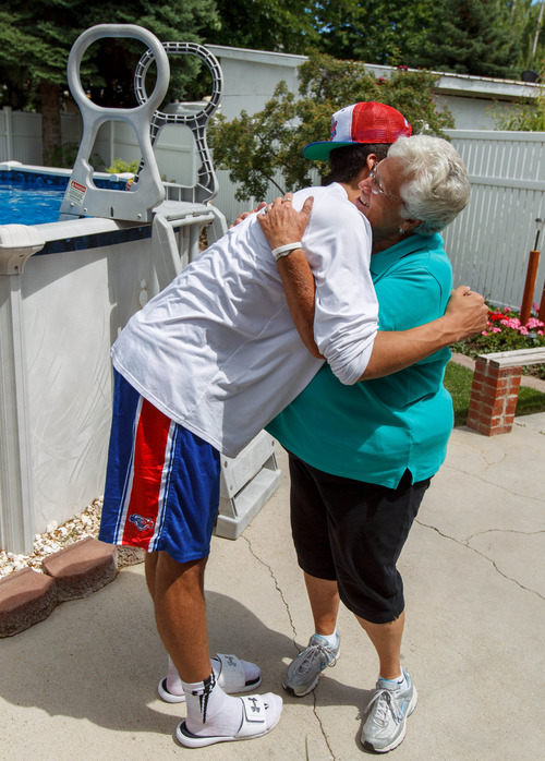Trent Nelson     The Salt Lake Tribune Roy High School's Brekkott Chapman embraces his grandmother Sharon Price. Chapman is becoming somewhat of a national phenomenon. The 6-foot-8 lefty has been invited to several national, high-end basketball camps this summer and has been the best player at nearly every one. Friday June 21, 2013 in Roy.