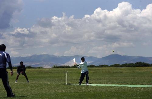 "Scott Sommerdorf   |  The Salt Lake Tribune A batsman for Utah Challengers at bat against ""Mind It"" in Salt Lake City, Saturday, July 13, 2013."