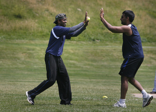 "Scott Sommerdorf   |  The Salt Lake Tribune Divakar Lakshmanan, left, of ""Mind It"" gets congratulations from Karthik Narayan, after making a nice defensive play against ""Utah Challengers"" in Salt Lake City, Saturday, July 13, 2013."