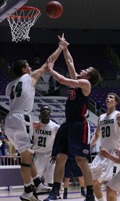 Leah Hogsten     The Salt Lake Tribune Olympus' Jake Lindsey, 44, blocks the shot of Woods Cross' Hayden Grant. Olympus High School defeated Woods Cross High School 50-43 during their 4A 2013 State Championships playoff game at Dee Events Center in Ogden, February 26, 2013.