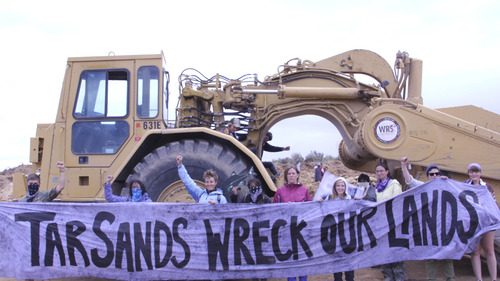 Courtesy | Steve Liptay/Peaceful Uprising Climate Justice activists halt mining operations and road construction at the first US tar sands stripmine, located in Eastern Utah.