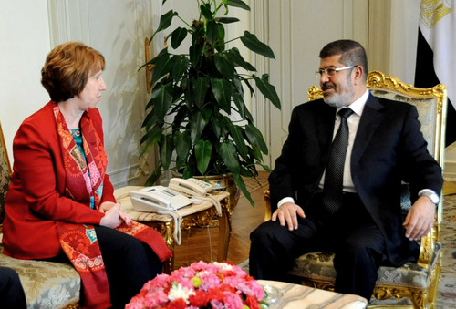 FILE - In this Wednesday, June 19, 2013 file image released by the Egyptian Presidency, Egyptian President Mohammed Morsi, right, meets with High Representative of the European Union for Foreign Affairs Catherine Ashton, at the Presidential Palace in Cairo, Egypt. Ashton held a two-hour meeting with  Morsi, the EU said on Tuesday, July 29, 2013, in the Islamist leader's first meeting with an outsider since the military deposed him nearly a month ago.  (AP Photo/Egyptian Presidency, File)