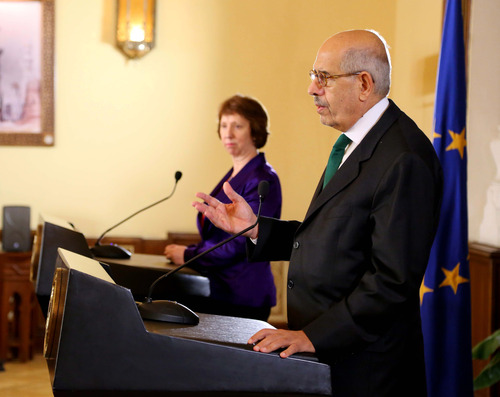 "This image released by the Egyptian Presidency shows interim Vice President Mohamed ElBaradei, foreground, making remarks at a joint news conference with EU foreign policy chief Catherine Ashton, center, at the presidential palace in Cairo, Egypt, Tuesday, July 30, 2013.  The European Union's top diplomat said Tuesday that deposed Egyptian President Mohammed Morsi is ""well"" and that the two had a ""friendly, open and very frank"" discussion about the country's political crisis and the need to move forward. Ashton's two-hour meeting with Morsi late Monday marked the first contact the ousted Islamist leader has had with the outside world since he was overthrown by a military coup on July 3. (AP Photo/Egyptian Presidency)"