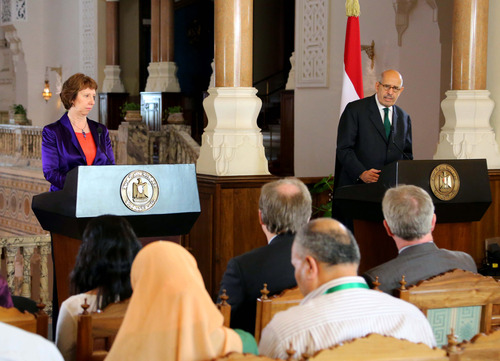 """This image released by the Egyptian Presidency shows interim Vice President Mohamed ElBaradei, right, making remarks at a joint news conference with EU foreign policy chief Catherine Ashton, left, at the presidential palace in Cairo, Egypt, Tuesday, July 30, 2013.  The European Union's top diplomat said Tuesday that deposed Egyptian President Mohammed Morsi is """"well"""" and that the two had a """"friendly, open and very frank"""" discussion about the country's political crisis and the need to move forward. Ashton's two-hour meeting with Morsi late Monday marked the first contact the ousted Islamist leader has had with the outside world since he was overthrown by a military coup on July 3. (AP Photo/Egyptian Presidency)"""