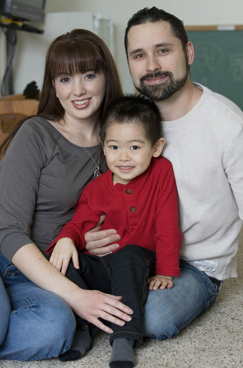 Paul Fraughton  |   The Salt Lake Tribune Stephanie and Harlan McCoy with their adopted son Gabe in their Saratoga Springs home.  Tuesday, February 5, 2013