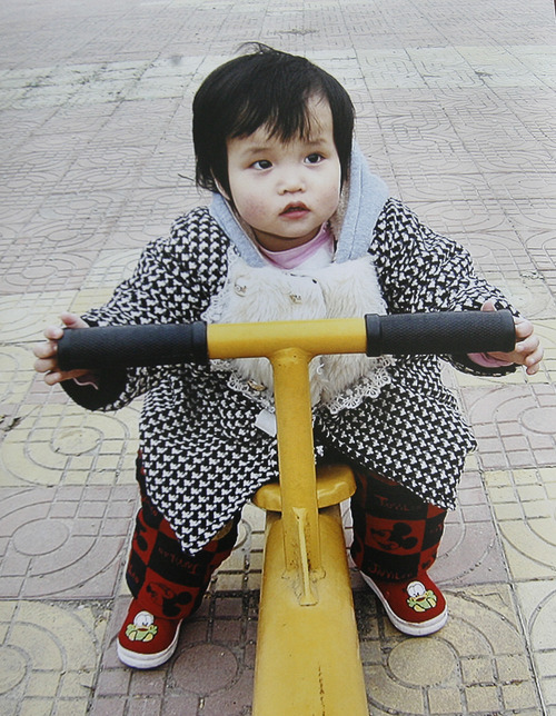 Scott Sommerdorf   |  The Salt Lake Tribune A photo of Lizzie when she was in China prior to the Anderegg's first adoption. Representative Jacob Anderegg and his wife Julie are in the process of adopting a second child - Ellie Mei - from China. As they did the first time, the Lehi couple are using crowdfunding to help cover adoption costs.