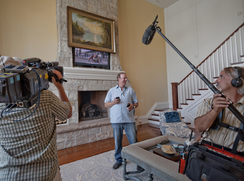 Homeowner Mark Ewell is interviewed on camera by the HGTV film crew on Tuesday, July 23, 2013. Ewell's home was being featured by the network on their Top 10 Homes in America special. Courtesy Michael Mangum - Upland Development