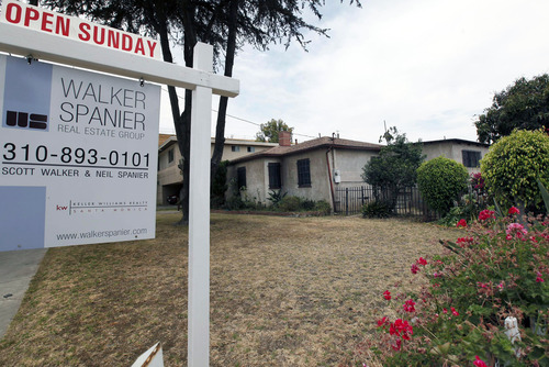 In this Tuesday, June 11, 2013, photo, a single house is offered for sale in Santa Monica, Calif.  Sandard & Poor's/Case-Shiller reports on home prices in May on Tuesday, July 30, 2013. (AP Photo/Nick Ut)