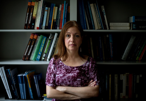 Lori Marino, a lecturer in psychology at Emory University who has conducted extensive research on the intelligence of whales, dolphins and primates, is photographed in her office in Atlanta on Friday, July 26, 2013. There's extensive evidence that pigs are as smart and sociable as dogs. Seeking to capitalize on that discrepancy, animal-welfare advocates are launching a campaign called The Someone Project that aims to depict farm animals as more intelligent and emotionally complex than is commonly believed. The hope is that increasing numbers of Americans might view these animals with the same empathy that they view dogs, cats, elephants, great apes and dolphins. (AP Photo/David Goldman)