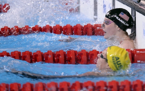 Missy Franklin of the United States, top, looks up after winning the gold medal in the Women's 100m backstroke final at the FINA Swimming World Championships in Barcelona, Spain, Tuesday, July 30, 2013 .(AP Photo/Manu Fernandez)