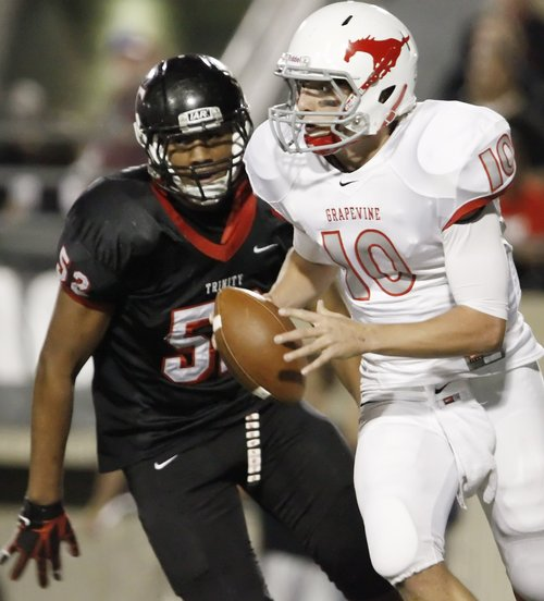 In this Oct. 21, 2011 photo, Trinity's junior defensive lineman Gaius Vaenuku (52) rushes Grapevine junior quarterback Brett Harbin (10) during a high school football game at Pennington Field in Bedford, TX.  Texas A&M officials say freshman NCAA college football defensive lineman Polo Manukainiu died in a rollover crash, Monday, July 29, 2013, in New Mexico during a trip home from Utah.  New Mexico State Police say Gaius Vaenuku, an incoming member of the Utah football team, also died after the wreck. Manukainiu was a 19-year-old redshirt freshman. (AP Photo/The Fort Worth Star-Telegram, Brandon Wade)