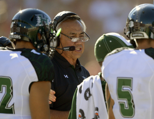 Mark J. Terrill | The Associated Press Hawaii head coach Norm Chow talks to members of his team during the first half of their NCAA college football game against Southern California, Saturday, Sept. 1, 2012, in Los Angeles. Formerly a coach at BYU where he used his Hawaii roots to recruit Polynesian players to Utah, he now has changed his pitch to encourage them to stay in Hawaii.