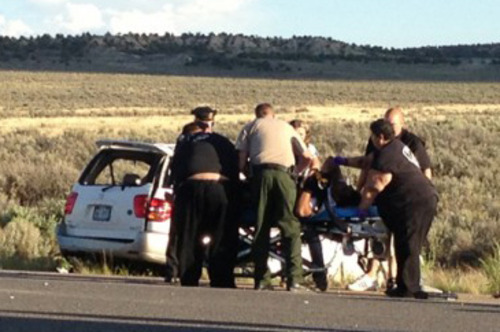 This video frame grab released by KRQE.com shows police and medical personal attending to car wreck that happened Monday evening on U.S. 550 near Cuba, about 85 miles north of Albuquerque. Texas A&M said Tuesday that redshirt freshman Polo Manukainiu and a teenager joining the Utah football team this fall were among three people killed in a single-car rollover crash in the high desert of northern New Mexico, just days before fall practices begin. (AP Photo/KRQE.com) MANDATORY CREDIT  LOCAL TV OUT  KOAT TV OUT,  KOB TV OUT