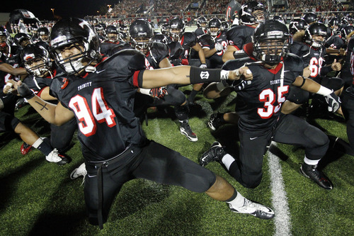 """In this Dec. 3, 2010 file photo, Trinity High School football players  Polo Manukainiu (94) and Paul Tuipulotu (35) perform a """"Haka"""" with the team before a game against Coppell in Southlake, Texas. Texas A&M officials say freshman NCAA college football defensive lineman Polo Manukainiu died in a rollover crash, Monday, July 29, 2013, in New Mexico during a trip home from Utah.  New Mexico State Police say Gaius Vaenuku, an incoming member of the Utah football team, also died after the wreck. Manukainiu was a 19-year-old redshirt freshman. (AP Photo/The Dallas Morning News, John F. Rhodes)  MANDATORY CREDIT; MAGS OUT; TV OUT; INTERNET USE BY AP MEMBERS ONLY; NO SALES"""