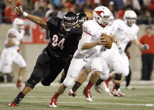 In this Oct. 21, 2011 photo, Trinity senior defensive lineman Polo Manukainiu (94) rushes Grapevine junior quarterback Brett Harbin (10) during a high school football game at Pennington Field in Bedford, Texas. Texas A&M officials say freshman NCAA college football defensive lineman Polo Manukainiu died in a rollover crash, Monday, July 29, 2013, in New Mexico during a trip home from Utah.  New Mexico State Police say Gaius Vaenuku, an incoming member of the Utah football team, also died after the wreck. Manukainiu was a 19-year-old redshirt freshman. (AP Photo/The Fort Worth Star-Telegram, Brandon Wade)  MAGS OUT; (FORT WORTH WEEKLY, 360 WEST);
