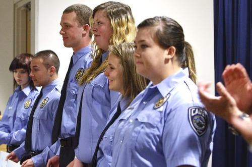 Leah Hogsten     The Salt Lake Tribune  The Salt Lake Honorary Colonels and Salt Lake County Sheriff Jim Winder ed scholarship checks to l-r Daryllin Zitting, Juan Rodriguez, McQuade Allen, Jessica Anglesey, Megan Kelsch and Jayci Wood, all Unified Police Department youth cadets to help them pay for their POST training, Tuesday, July 30,2013.