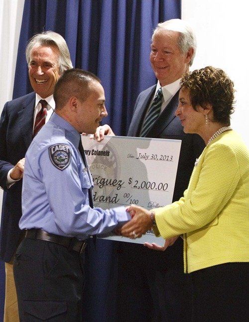 Leah Hogsten     The Salt Lake Tribune Cadet Juan Rodriguez is congratulated by l-r Colonels Bill Wirthlin, David Freed and Connie Deianni.  The Salt Lake Honorary Colonels and Salt Lake County Sheriff Jim Winder ed scholarship checks to 6 Unified Police Department youth cadets to help them pay for their POST training, Tuesday, July 30,2013.