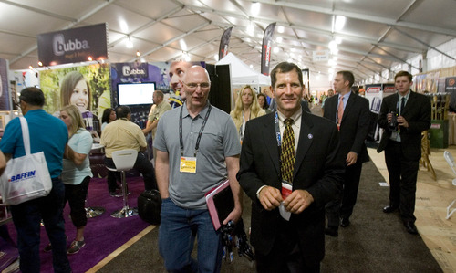 Paul Fraughton  |   The Salt Lake Tribune Kirk Bailey, vice president of government affairs for the Outdoor Industry Association, and Brad Petersen, the newly appointed director of the Utah Office of Outdoor Recreation, tour this year's Outdoor Retailers Summer Market at the Salt Palace Convention Center. Wednesday, July 31, 2013