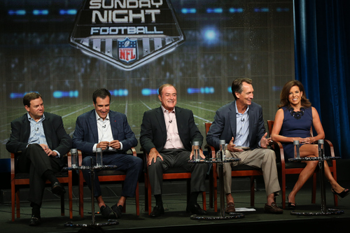 """This publicity image released by NBC shows, from left, Mark Lazarus, Chairman of NBC Sports Group, coordinating producer Fred Gaudelli, Al Michaels, analyst Cris Collinsworth, and sideline reporter Michele Tafoya at the """" Sunday Night Football"""" session during the NBCUniversal Press Tour in Beverly Hills, Calif., on Saturday, July 27, 2013.  (AP Photo/NBC, Chris Haston)"""
