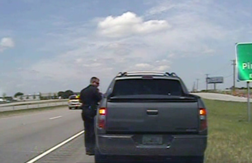 City of Forney Police Department  |  The Associated Press In this image taken from dashcam video provided by the City of Forney Police Department, a police officer speaks with George Zimmerman, the neighborhood watch volunteer acquitted by a Florida jury of charges in the fatal shooting of a black teenager, after he was pulled over for speeding along U.S. 80, about 20 miles east of Dallas on Sunday. Zimmerman was released with a warning.