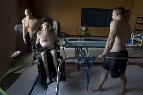 Steve Griffin  |  The Salt Lake Tribune   Brooke Hopkins, who was paralyzed from a bicycle accident three years ago, physical therapist Matt Hansen, left, and Mike Erickson prepare for pool therapy  at Neuroworx in South Jordan, Utah Friday, November 11, 2011.