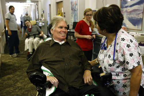 Leah Hogsten  |  The Salt Lake Tribune Brooke Hopkins gets a congratulatory greetings and well-wishes from his nurses and staff members as he leaves his long-term care facility. Two years and two weeks after Brooke Hopkins, a retired University of Utah English professor, was paralyzed after a bike collision in City Creek Canyon, he finally gets to leave South Davis Community Hospital and return home for in-home care on Wednesday, December 1, 2010, in SLC.