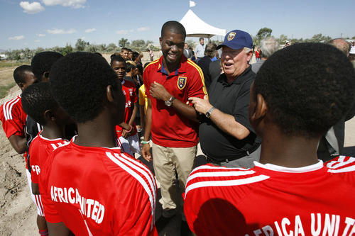 Francisco Kjolseth  |  The Salt Lake Tribune Real Salt Lake (RSL) owner Dell Loy Hansen, center left, jokes around with RSL defender Kwame Watson-Siriboe as they meet members of the Africa United youth team following an event to recognize both the official re-start of construction on the city's voter-approved Regional Athletic Complex (RAC) and RSL's gift of $7.5 million to help complete the project near 2100 North Rose Park Lane on Thursday, Aug. 1, 2013.