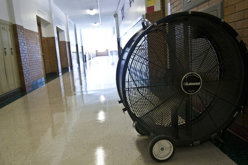 Chris Detrick  |  The Salt Lake Tribune A fan used to circulate air in the hallways at West Jordan Middle School, which would be torn down under a preliminary plan for a $501 million bond in the Jordan School District. It would allocate $30 million to replace West Jordan Middle School and $16 million to replace West Jordan Elementary.