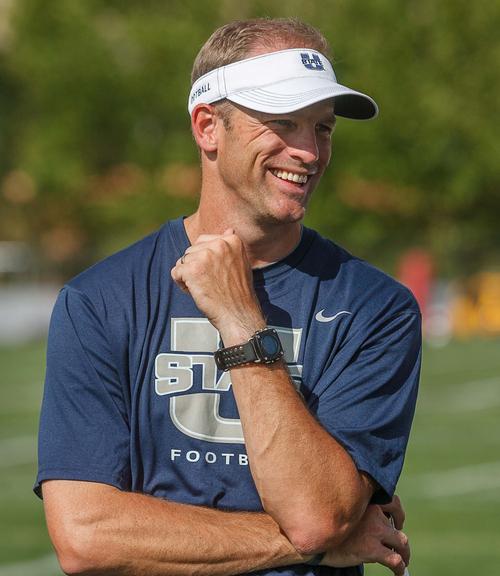 Trent Nelson     The Salt Lake Tribune Utah State University's new offensive coordinator Matt Wells at football practice in Logan, Utah Wednesday, August 22, 2012.