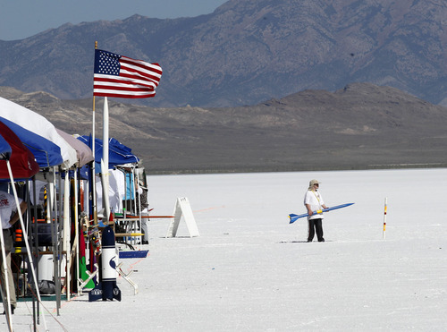 Al Hartmann     The Salt Lake Tribune A young rocketeer arrives on the Bonneville Salt Flats Thursday morning for Hellfire 18, a Utah Rocket Club event in which amateur rocket enthusiasts launch a variety of model rockets up to three miles in the air.