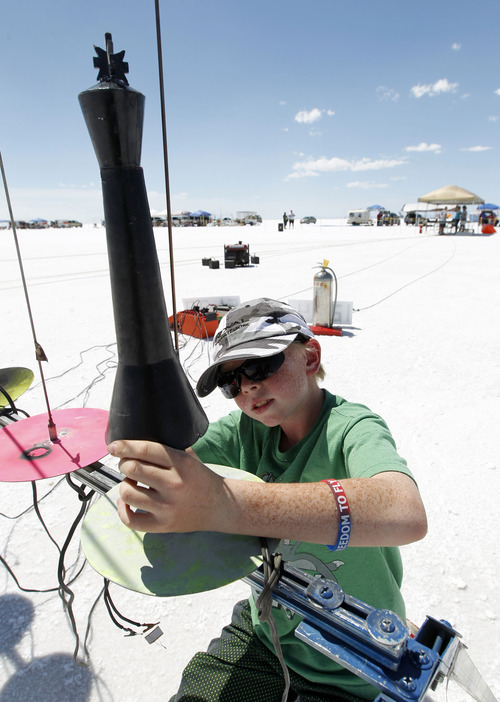 Al Hartmann     The Salt Lake Tribune Kage Hall sets up his rocket shaped as a king chess piece to ready it for flight over the Bonneville Salt Flats Thursday morning for Hellfire 18, a Utah Rocket Club event in which amateur rocket enthusiasts launch a variety of model rockets up to three miles in the air.