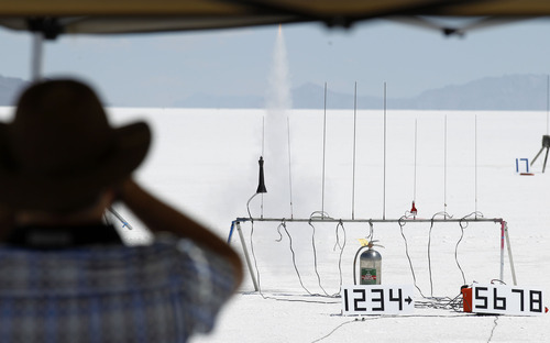 Al Hartmann     The Salt Lake Tribune The first rocket is fired by remote control above the Bonneville Salt Flats Thursday morning for Hellfire 18, a Utah Rocket Club event in which amateur rocket enthusiasts launch a variety of model rockets up to three miles in the air.