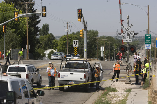 Rick Egan  | The Salt Lake Tribune   Police re-route traffic in Roy after a car was hit by the FrontRunner this morning, killing the driver, on 4800 South 2700 West in Roy, Friday, August 2, 2013.